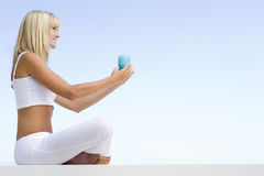 Woman meditating outside Stock Image
