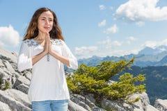Woman meditating ouutdoors in summer Stock Image