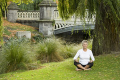 Woman meditating in park Royalty Free Stock Images