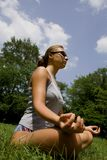 Woman meditating in park. In summer Royalty Free Stock Image