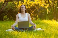 Woman meditating at the park Royalty Free Stock Photo