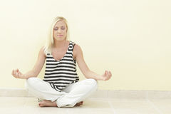 Woman in a meditating pose Royalty Free Stock Photo