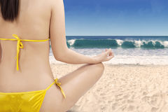 Woman with meditating pose at beach Royalty Free Stock Photo