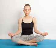 Woman meditating in pose of lotus Royalty Free Stock Image