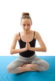 Woman meditating in pose of lotus Stock Photography