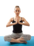 Woman meditating in pose of lotus Royalty Free Stock Photo