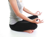 Woman meditating in pose. Portrait of young woman meditating in pose Royalty Free Stock Photo