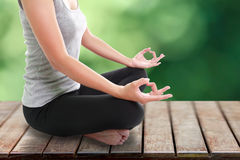 Woman meditating in pose. Portrait of young woman meditating in pose Stock Photography