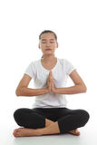 Woman meditating in pose. Portrait of young woman meditating in pose Stock Photo