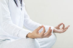 Woman meditating of purity energy insight on gray background, soft focus Royalty Free Stock Photography
