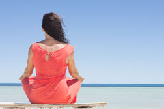 Woman meditating relaxed beach holiday Stock Photo