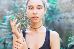Woman meditating on sacred geometry stock photo