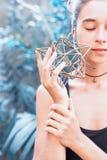 Woman meditating on sacred geometry. Beautiful woman meditating on sacred geometry Royalty Free Stock Image