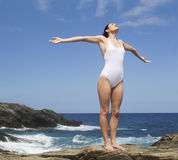 A woman meditating by the sea Royalty Free Stock Photography