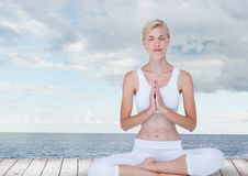 Woman Meditating by sea royalty free stock photos