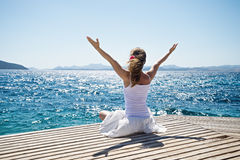 Woman meditating at the sea Stock Photos