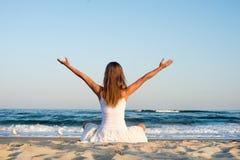 Woman meditating at the sea Royalty Free Stock Photos