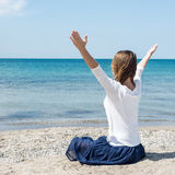 Woman meditating at the sea Stock Photography