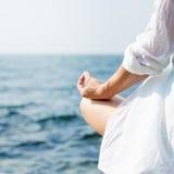 Woman meditating at the sea Royalty Free Stock Photo