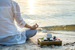 Woman meditating. At the sea with tea cup Royalty Free Stock Photos