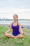 Woman meditating by the sea. Royalty Free Stock Photos