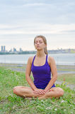 Woman meditating by the sea. Royalty Free Stock Images