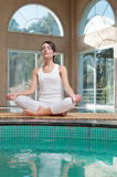 Woman meditating sitting in lotus position Stock Image