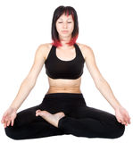 Woman meditating sitting in a yoga position Stock Photography