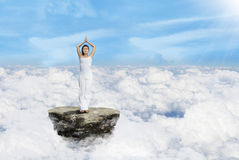 Woman meditating on the sky Stock Photo