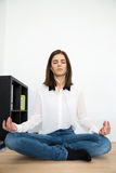 Woman meditating at the table in office Royalty Free Stock Photo