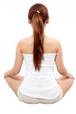 Woman meditating taken from behind Stock Images