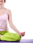 Woman meditating on a violet matting Stock Photography