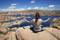 Woman Meditating at Watson Lake Stock Photo