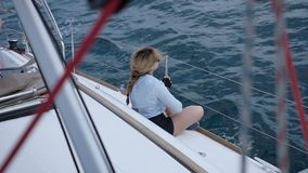 Woman meditating on yacht. Beautiful woman meditating on yacht stock video