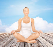 Woman  meditating in yoga lotus pose Royalty Free Stock Photography