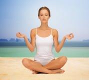 Woman  meditating in yoga lotus pose Royalty Free Stock Photos