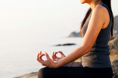 The woman meditating in a yoga pose . Royalty Free Stock Photos
