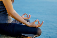 The woman meditating in a yoga pose on the tropical beach. Femal Royalty Free Stock Photo