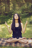 Woman meditating in yoga position Royalty Free Stock Photos