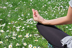 Woman meditating in yoga position in nature close up. Stock Photography