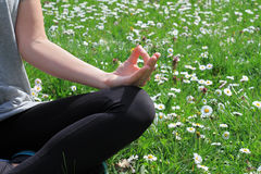 Woman meditating in yoga position in nature close up. Royalty Free Stock Photos