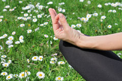 Woman meditating in yoga position in nature close up. Stock Image