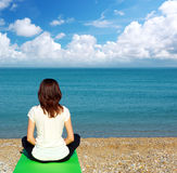 Woman in meditation. On the sea. Spiritual scene Stock Images