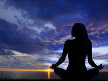 Woman Meditation. Woman meditating at sunset in beach environment Royalty Free Stock Images