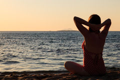 Woman meditation on the beach Stock Photography