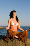 Woman meditation in the beach. Young woman meditation in the beach Stock Images