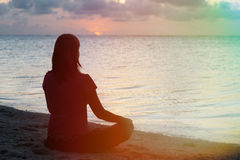 Woman meditation on the beach Royalty Free Stock Images