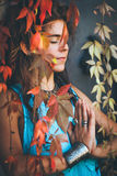 Woman in meditation behind leaves Royalty Free Stock Images
