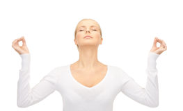 Woman in meditation. Bright picture of woman in meditation over whiter stock photo