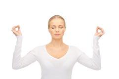 Woman in meditation Stock Photo